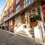 London Edwardian mansion apartment block. LONDON, UK - 17 MAY 2018: A low angle view of the entrance to a typical London Edwardian mansion block of flats from Stock Image