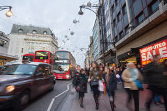 LONDON, ENGLAND – DECEMBER 30, 2014: Oxford street on sale sea. Son after Christmas. This street is a major shopping street of London Royalty Free Stock Photos