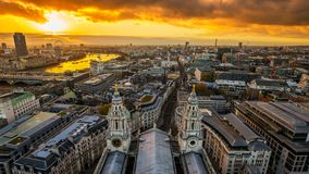 London, England - Aerial panoramic skyline view of London taken from top of St.Paul`s Cathedral at sunset. With beautiful golden sky and clouds stock photography