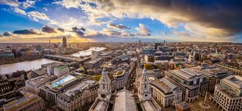 London, England - Aerial panoramic skyline view of London taken from top of St.Paul`s Cathedral. With dramatic clouds at sunset stock images