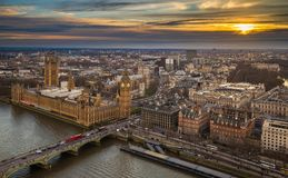 London, England - Aerial skyline view of the Big Ben and Houses of Parliament, Westminster Bridge with red double decker buses Stock Photos