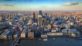 London, England - Aerial skyline view of the city of London at sunset. This view includes River Thames, the financial Bank district, London bridge, famous royalty free stock images