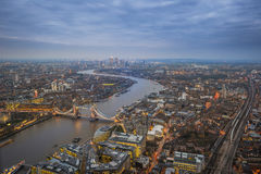 London, England - Aerial Skyline view of London. With the iconic Tower Bridge, Tower of London and skyscrapers of Canary Wharf at dusk royalty free stock photos
