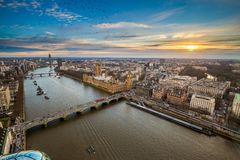 London, England - Aerial view of central London, with Big Ben, Houses of Parliament, Westminster Bridge. Lambeth Bridge at sunset with flying birds Stock Photography