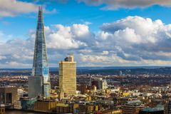 London, England - Aerial view of the Shard, London`s highest skyscraper at sunset. With nice clouds and blue sky stock photography
