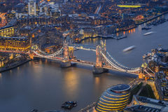 London, England - Aerial view of the world famous Tower Bridge. City Hall and the Tower of London by night stock photography