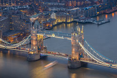 London, England - Aerial view of the world famous Tower Bridge. By night stock photography