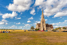 LONDON, ENGLAND - AUGUST 21, 2016: Blackheath with All Saints. Greenwich park with Cloudy Blue Sky and Green Grass. Royalty Free Stock Photos
