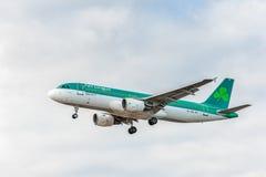 LONDON, ENGLAND - AUGUST 22, 2016: EI-CVA Aer Lingus Airbus A320 Landing in Heathrow Airport, London. Airplane is Landing in London, Heathrow Airport. United royalty free stock photography