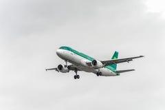 LONDON, ENGLAND - AUGUST 22, 2016: EI-DEG Aer Lingus Airbus A320 Landing in Heathrow Airport, London. Royalty Free Stock Images
