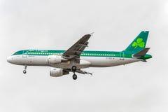 LONDON, ENGLAND - AUGUST 22, 2016: EI-DEG Aer Lingus Airbus A320 Landing in Heathrow Airport, London. Stock Image