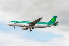 LONDON, ENGLAND - AUGUST 22, 2016: EI-DVE Aer Lingus Airbus A320 Landing in Heathrow Airport, London. Stock Image