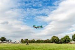 LONDON, ENGLAND - AUGUST 22, 2016: EI-DVI Aer Lingus Airbus A320 Landing in Heathrow Airport, London. Airplane is landing in Heathrow Airport, London, England stock photo