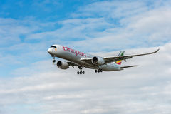 LONDON, ENGLAND - AUGUST 22, 2016: ET-ATR Ethiopian Airlines Airbus A350 Landing in Heathrow Airport, London. Airplane is landing in Heathrow Airport, London Royalty Free Stock Photo