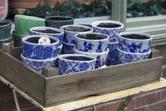 Flower pots with blue ornament for sale at the entrance to the flower shop. LONDON, ENGLAND - August 20, 2017 flower pots with blue ornament for sale at the stock image