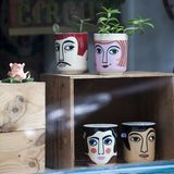 Funny cups with male and female faces in the shop window for sale Royalty Free Stock Images