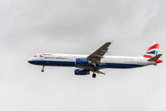 LONDON, ENGLAND - AUGUST 22, 2016: G-MEDJ British Airways Airbus A321 Landing in Heathrow Airport, London. Royalty Free Stock Images