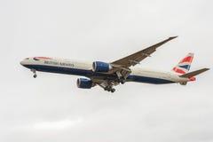LONDON, ENGLAND - AUGUST 22, 2016: G-STBA British Airways Boeing 777 Landing in Heathrow Airport, London. Royalty Free Stock Photography
