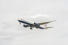 LONDON, ENGLAND - AUGUST 22, 2016: G-STBI British Airways Boeing 777 Landing in Heathrow Airport, London. Royalty Free Stock Photo