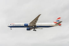 LONDON, ENGLAND - AUGUST 22, 2016: G-STBI British Airways Boeing 777 Landing in Heathrow Airport, London. Royalty Free Stock Image