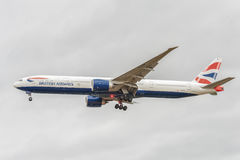 LONDON, ENGLAND - AUGUST 22, 2016: G-STBI British Airways Boeing 777 Landing in Heathrow Airport, London. Stock Photo