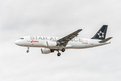 LONDON, ENGLAND - AUGUST 22, 2016: HB-IJO Swiss Star Alliance Livery Airlines Airbus A320 Landing in Heathrow Airport, London. Stock Photography