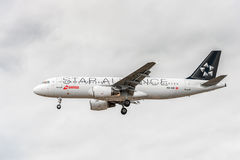 LONDON, ENGLAND - AUGUST 22, 2016: HB-IJO Swiss Star Alliance Livery Airlines Airbus A320 Landing in Heathrow Airport, London. Stock Image