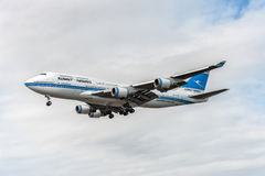 LONDON, ENGLAND - AUGUST 22, 2016: 9K-ADE Kuwait Airways Boeing 747 Landing in Heathrow Airport. Airplane is landing in Heathrow Airport, London, England Royalty Free Stock Image