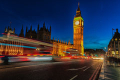 LONDON, ENGLAND - AUGUST 22, 2016: London Big Ben and Westminster Bridge with Palace of Westminster. Blurry people because of Long Royalty Free Stock Photos