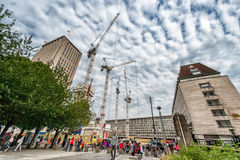 LONDON, ENGLAND - AUGUST 18, 2016: London Downtown with People and Construction Area. Shell Centre in Background with Cloudy Blue Royalty Free Stock Photo