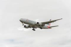 LONDON, ENGLAND - AUGUST 22, 2016: N795AN American Airlines Boeing 777 Landing in Heathrow Airport, London. Royalty Free Stock Image