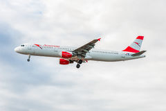 LONDON, ENGLAND - AUGUST 22, 2016: OE-LBB Austrian Airlines Airbus A321 Landing in Heathrow Airport, London. Airplane is Landing in London, Heathrow Airport Stock Photo