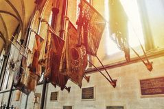 LONDON, ENGLAND - AUGUST 02, 2013: Old flags in the interior of stock images