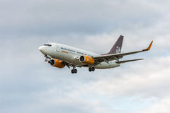 LONDON, ENGLAND - AUGUST 22, 2016: OY-JTT Jettime Jet Time Airlines Boeing 737 Landing in Heathrow Airport, London. Royalty Free Stock Photo