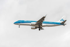 LONDON, ENGLAND - AUGUST 22, 2016: PH-EZF KLM Cityhopper Embraer ERJ-190 Landing in Heathrow Airport, London. Royalty Free Stock Photo