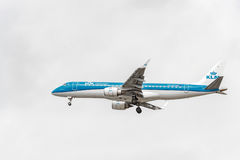 LONDON, ENGLAND - AUGUST 22, 2016: PH-EZF KLM Cityhopper Embraer ERJ-190 Landing in Heathrow Airport, London. Royalty Free Stock Images