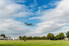 LONDON, ENGLAND - AUGUST 22, 2016: PH-EZV KLM Cityhopper Embraer ERJ-190 Landing in Heathrow Airport, London. Royalty Free Stock Images