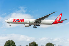 LONDON, ENGLAND - AUGUST 22, 2016: PT-MUC LATAM Brasil TAM Linhas Aereas Boeing 777 Landing in Heathrow Airport, London. Royalty Free Stock Photo