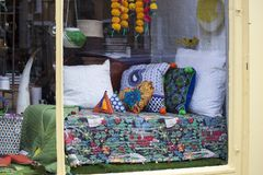 Shop window with bedding in patchwork technique Royalty Free Stock Photo