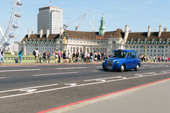 London, England - 31 August 2016: Typical London taxi crosses Westminster Bridge. Royalty Free Stock Photos