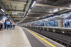 LONDON, ENGLAND - AUGUST 18, 2016: Westminster Underground Station in London, England. Blurry People because of Long Exposure. Stock Images