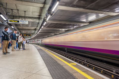 LONDON, ENGLAND - AUGUST 18, 2016: Westminster Underground Station in London, England. Blurry Train because of Long Exposure. royalty free stock photos