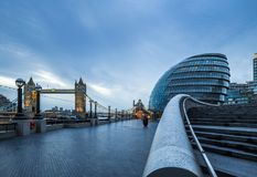 London, England - Beautiful illuminated Tower Bridge and office buildings on a rainy day. At blue hour Royalty Free Stock Images