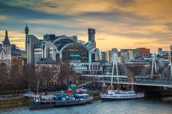 London, England - Beautiful sky and clouds at Charing Cross station and Golden Jubilee Bridge. At Embankment before sunset Stock Image