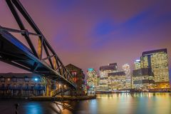 London, England - Colorful night sky at Canary Wharf financial district with skyscapers. And residential buildings at the docklands of London by night Stock Image