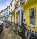 London, England - Colorful Victorian houses of Primrose hill with british style umbrella Royalty Free Stock Image