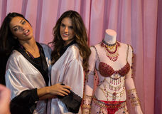 LONDON, ENGLAND - DECEMBER 02: Adriana Lima(L) and Alessandra Ambrosio (R) pose backstage Stock Image