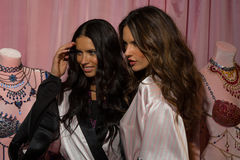 LONDON, ENGLAND - DECEMBER 02: Adriana Lima(L) and Alessandra Ambrosio (R) pose backstage Stock Photo