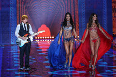 LONDON, ENGLAND - DECEMBER 02: Ed Sheeran performs as models walk the runway at the annual Victoria's Secret fashion show Royalty Free Stock Image