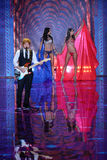 LONDON, ENGLAND - DECEMBER 02: Ed Sheeran performs as models walk the runway at the annual Victoria's Secret fashion show Stock Image